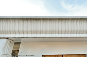 FAQs - Gutter Streaks - Tiger Striping due to improper drainage to downspout - Gutter Tex Austin TX