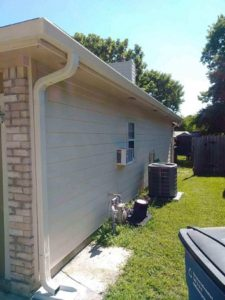 Downspouts - Gutter Tex - Austin, TX - Gutters and downspout on eave of tan house