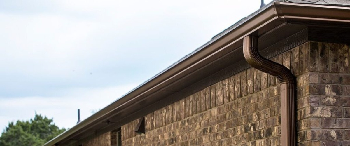Gutter Repair - Gutter TEX - Austin, TX - Brown k-style gutters on brown brick house
