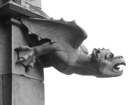 History of Gutters - Gargoyle Downspout on Roof in Middle Ages