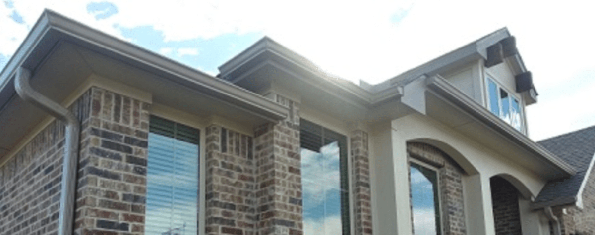 Gutter Installation - Gutter Tex - Lakeway, TX - Colonial gray rain gutters on brick and stucco multi-level home