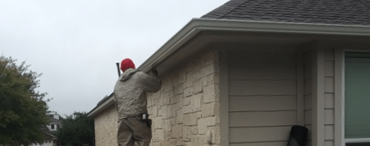 Gutter Installation and Repair - Gutter Tex - Dripping Springs, TX - Man installing seamless gutters