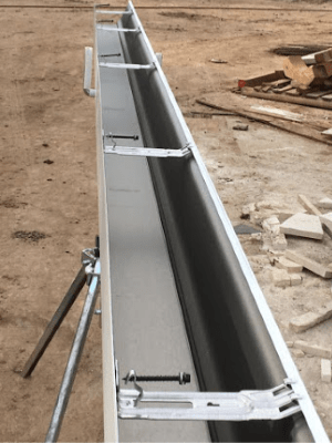 Seamless Rain Gutter - Gutter Tex - San Marcos, TX - Gutter on stand at construction site