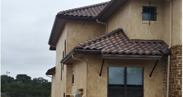 Seamless Rain Gutters - Gutter Tex - Spring Branch, TX - Adobe roof with brown rain gutters and downspouts color matched
